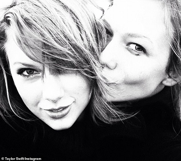 Mystery: Fans of 10-time Grammy Award-winning Taylor Swift (left) are said to think her extra track from Evermore's Time to Go - which hit streaming services on Thursday - is about her ex-boyfriend, Karlie Kloss (on the right, pictured in 2014)